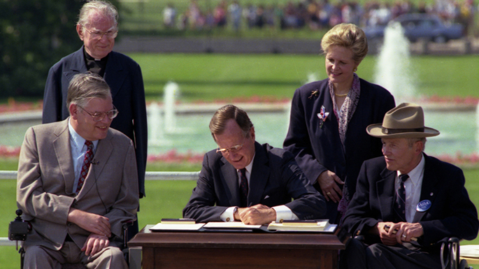 President George H.W. Bush signing the American with Disabilities Act
