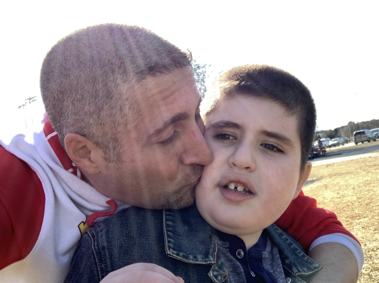 Father kissing his son on the cheek