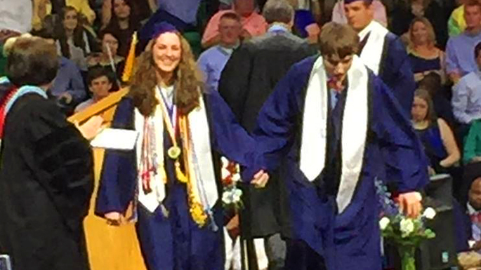 Sibling Walks Alongside Twin Brother With Autism At Graduation Autism Speaks