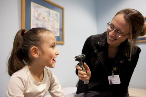 A doctor and young patient at the Thompson Center for Autism and Neurodevelopmental Disorders