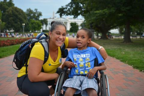 Woman and young child with autism in wheelchair in front of White House
