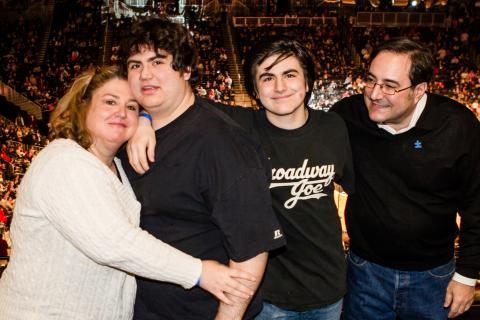 Family of four at autism-friendly event at Barclays Center.