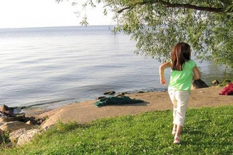child running by a lake