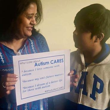 Tulika Prasad and son Vedant holding a sing saying why they care about Autism CARES