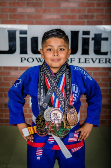 Alex Felipe's jiu-jitsu training has helped him with social skills working with others in class.